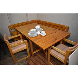 Pine corner kitchen bench with storage, a pine drop leaf table and two oak framed side chairs