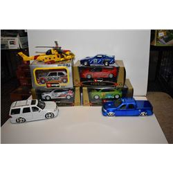 Selection of new in box Vurago race cars plus unboxed Ford F-150, Lincoln Navigator, helicopter etc.