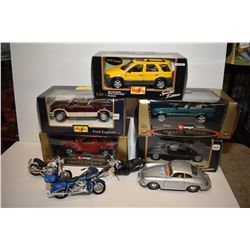 Four boxed Vurago and Maisto cars and trucks including Range Rover, Ford Escape, Ford Explorer etc.