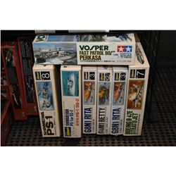 Seven unassembled model kits including six airplanes, Strato jet, PS-1 and a Fast Patrol boat