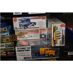 Four unassembled model kits of heavy equipment including D8H Caterpillar, Kenworth and Peterbilt tru