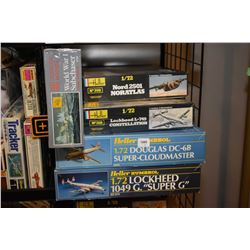 Five unassembled aircraft model kits including Lockheed Super G, Douglas Super-Cloudmaster, Lockheed