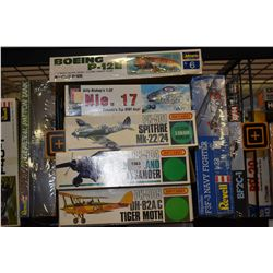 Seven unassembled aircraft model kits including Tiger Moth, Spitfire, NIE 17 etc.