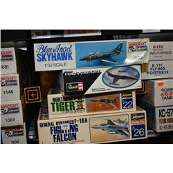 Four unassembled aircraft model kits including Blue Angel Skyhawk, Fighting Falcon, F104 Starfighter