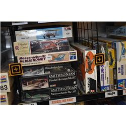 Seven unassembled aircraft model kits including Hawker Hurricane, Mitubishi Zero, Boeing P-12 E figh