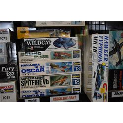 Nine unassembled aircraft model kits including Grumman Wildcat, Hawker Typhoon, Boeing P-12 E, Super