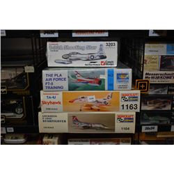 Four unassembled aircraft model kits including T-33A Shooting Star, TA-4J Skyhawk, Lockheed F104 C S
