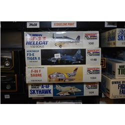 Four unassembled aircraft model kits including A-4F Skyhawk, F-86F Sabre, Grumman Hellcat etc.