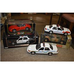 Three new in box die cast including Maisto Humvee, Vurago Viper, Motormax Police car plus two unboxe