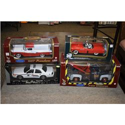 Four new in box die cast cars including 1957 Ford Rangero, RCMP Cruiser, F-100 Wrecker etc.