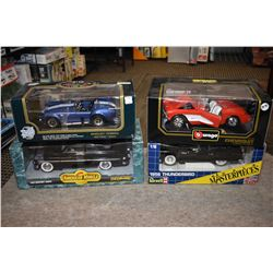 Four new in box 1:18th scale die cast cars including 1957 Corvette, 1956 T-Bird, 1949 Mercury and a