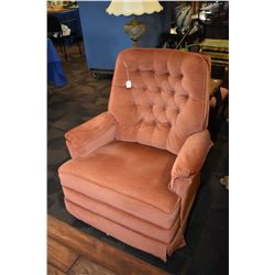 Rocker recliner with button tufted upholstery