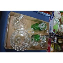 Selection of crystal collectibles including green cut to clear bottles with stoppers, cruet, comport
