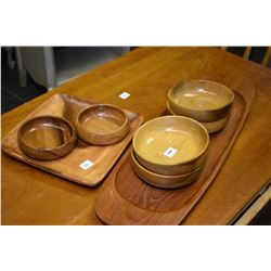 Selection of wooden serving pieces including myrtle wood bowls, etc