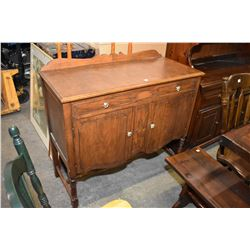 Antique style walnut sideboard Antique style small walnut two door, single drawer sideboard with low