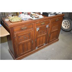 Antique thistle carved sideboard Antique three drawer, three door sideboard with carved thistle desi