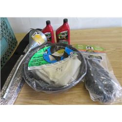 LOT OF ASSORTED OIL CHANGE ITEMS ( OIL, FUNNEL, SHOE STUDS, ETC…)