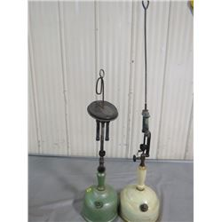2 COLEMAN SUNSHINE OF THE NIGHT LAMPS-1 IS 32.5 INCHES TALL & 1 IS 23 INCHES TALL