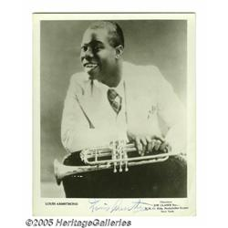 "Louis Armstrong Signed Photograph. An 8"" x 10"" bl"