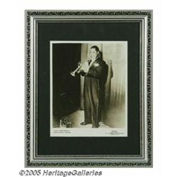 "Louis Armstrong Signed Photograph. An 8"" x 10"" ma"