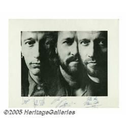 Bee Gees Signed Photograph. Formed in the mid- to