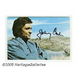 "Johnny Cash Signed Postcard. A 3"" x 5"" picture po"