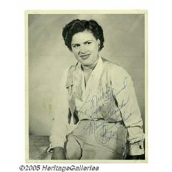 "Patsy Cline Signed Photograph. An 8"" x 10"" black"