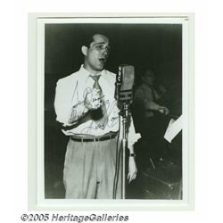 Perry Como Signed Photograph. A black and white 8