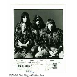 """Ramones Signed Photograph. An 8"""" x 10"""" black-and-"""