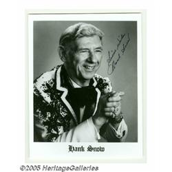 """Hank Snow Signed Photographs. Two 8"""" x 10"""" black-"""