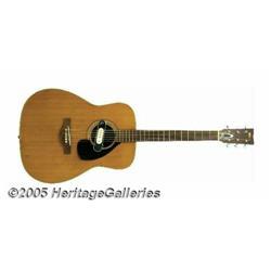 Lightnin' Hopkins Played Guitar. Featured is a Ya