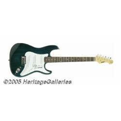 Val Kilmer Signed Guitar. Actor Val Kilmer has pl