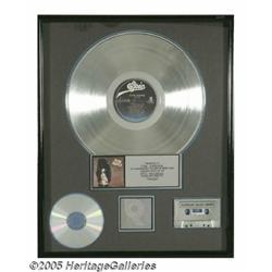 Alice Cooper Platinum Sales Award. Presented to T