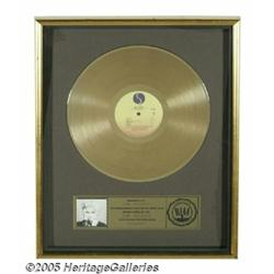 "Madonna Gold Record Award. ""Floater""-style award"
