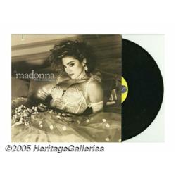 Madonna LPs and Photo Proofs Included are two pro