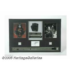 KISS: Gene Simmons Worn Costume Display. Large di