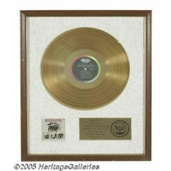 Beatles '65 Gold Record Award. Presented to the b