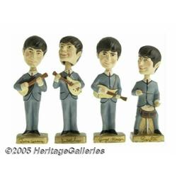 Bobb'n Head Beatles Toys. Bobble-head toys are pr