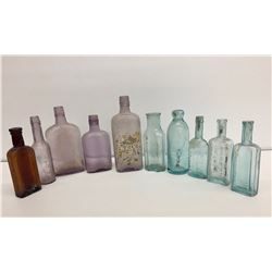 Group of 10 Antique Bottles with Advertising