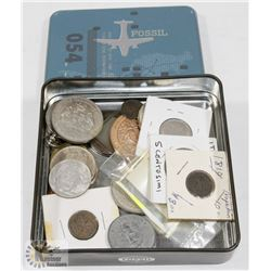 FOSSIL BOX FULL OF  ASSORTED WORLD COINS