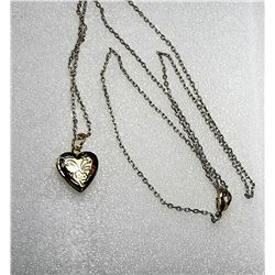 17)  GOLD TONE ETCHED HEART LOCKET