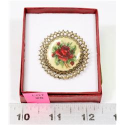 ESTATE BROOCH OF A NEEDLEPOINT ROSE