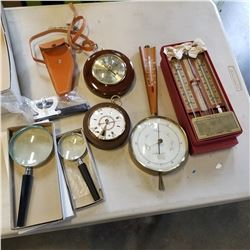 BAROMETERS THERMOMETERS AND MAGNIFYING GLASSES