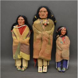 THREE SKOOKUM DOLLS