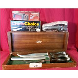 A Boxed Set Of Cutco Carving Knives And A Chefs Choice Sharpener