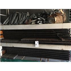 2 SHELVES OF BEAM CLIPS, AND A SHELF OF BARBED WIRE ATTACHMENTS FOR CHAIN LINK FENCING