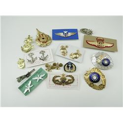 ASSORTED INTERNATIONAL BADGES AND PINS