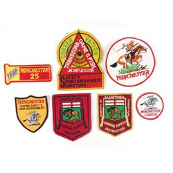 ASSORTED SHOOTING RELATED PATCHES/ JACKET CRESTS