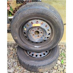 2-5x4.25x16 stock steel rims with 215/65R16 tires approx. 60% tread