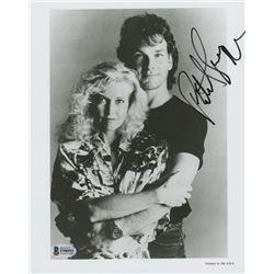 "Patrick Swayze Signed ""Steel Dawn"" 8x10 Photo (Beckett COA)"